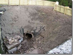 Reinstated garden shows the diversion pipe now available to help with the management of water