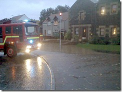 Fire engine pumping out flood waters
